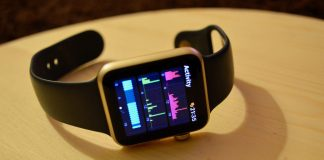 Frontview of Apple Watch with Activity Tracking Interface on a Wooden Table Side as part of Apple Watch Hacks