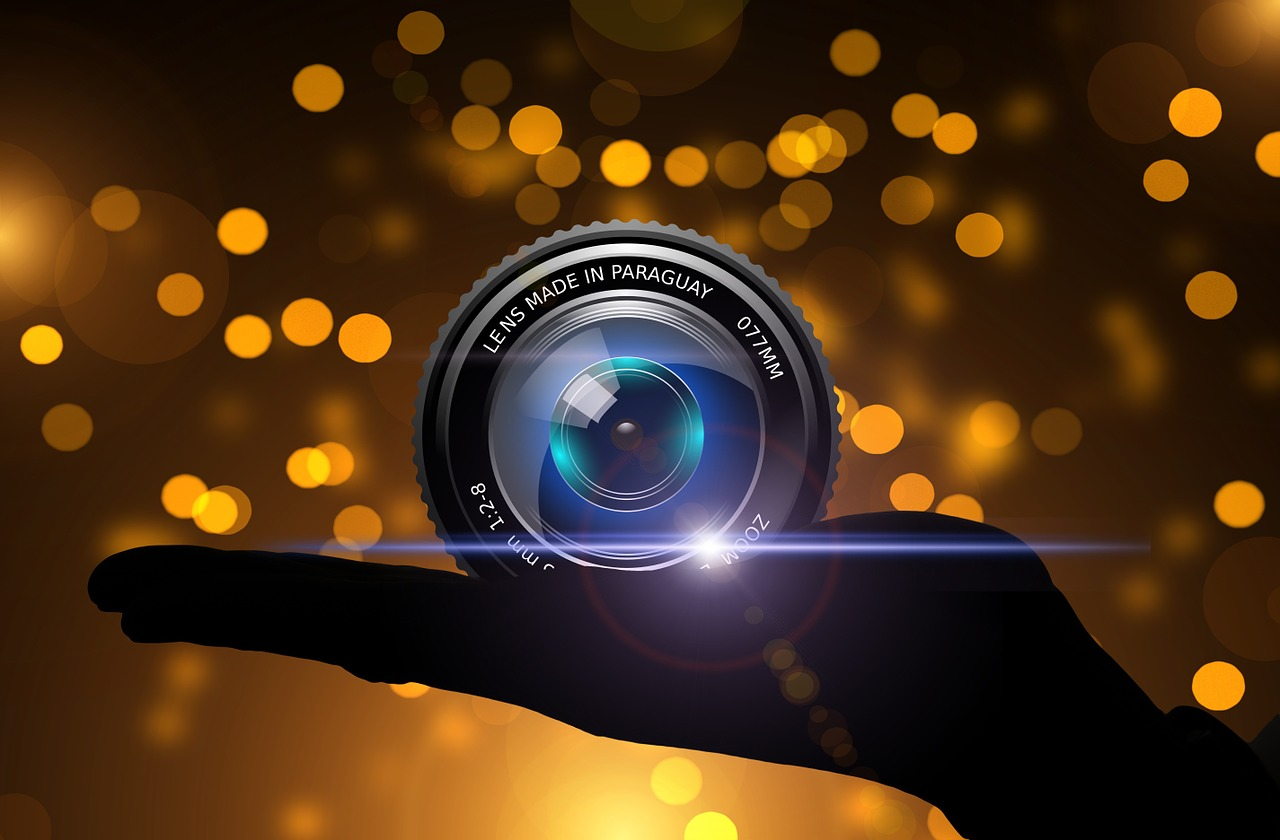 using digital camera to take photos is an example of a person with technology background