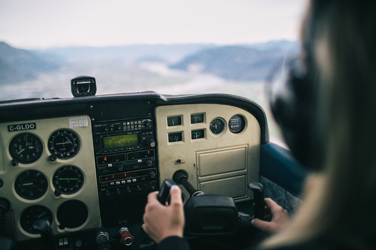 a pilot flying a plane is an example of a person with technology background