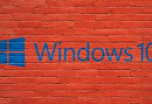 a logo of windows 10 with red wall background
