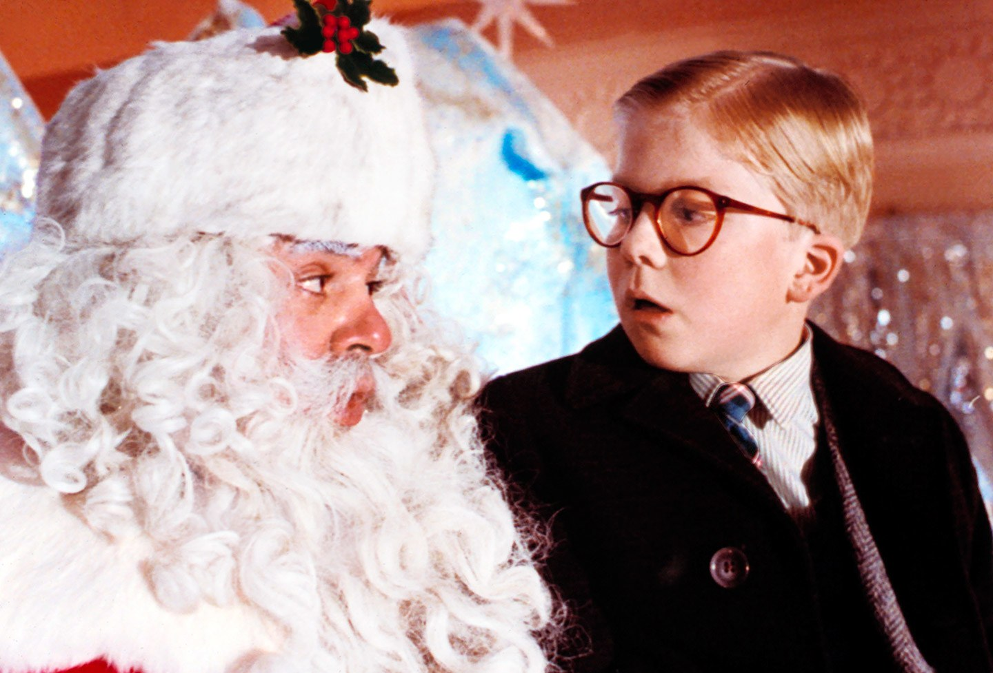 boy with glasses sitting on Santa's lap from A Christmas Story movie