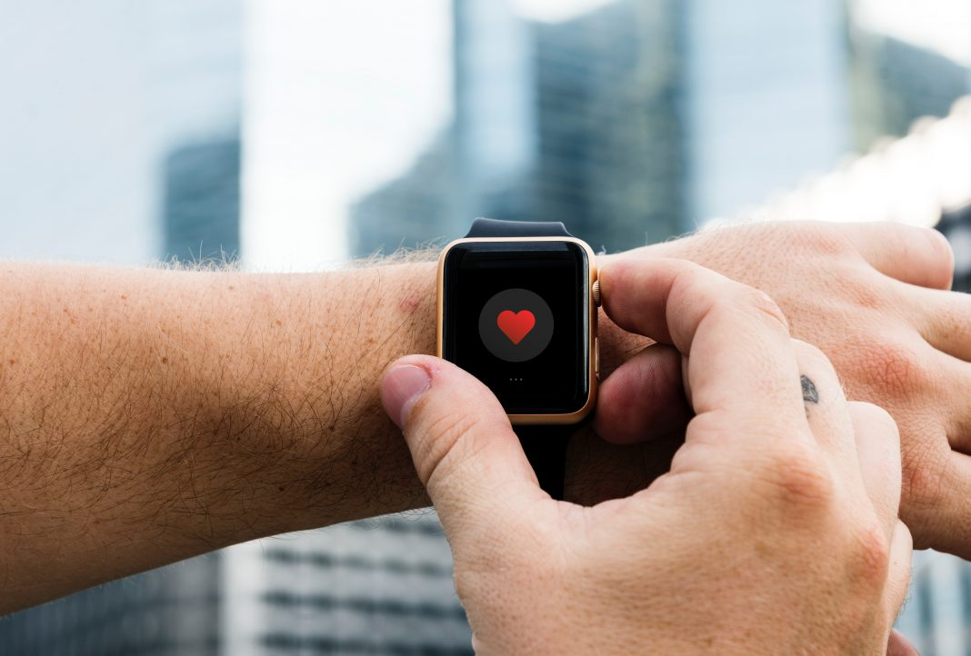 google smartwatch smartwatch with heart logo on screen