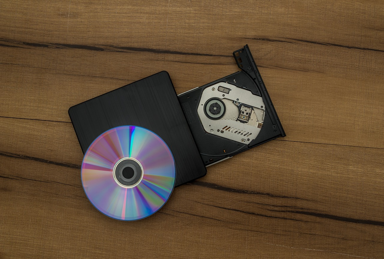 Compact Disc on top of a CD burner